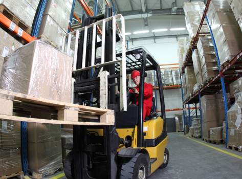 Forklift in warehouse.