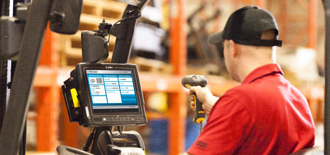 Scanning device on a forklift in a warehouse.